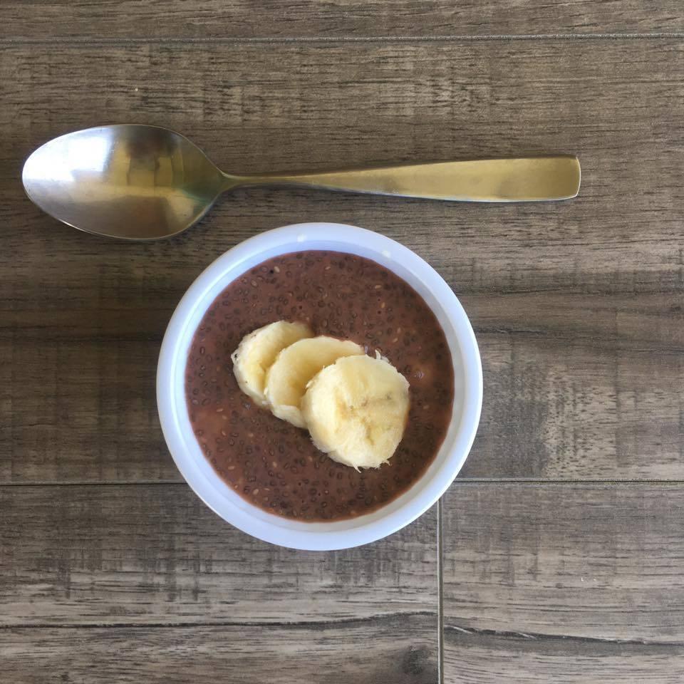Chocolate Banana Chia Seed Pudding with spoon overhead