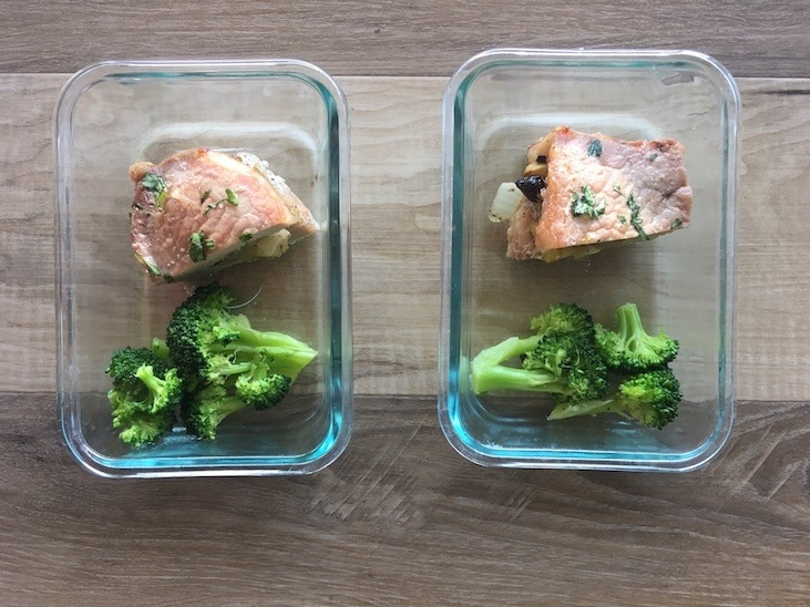 Apple stuffed pork chops divided into two containers