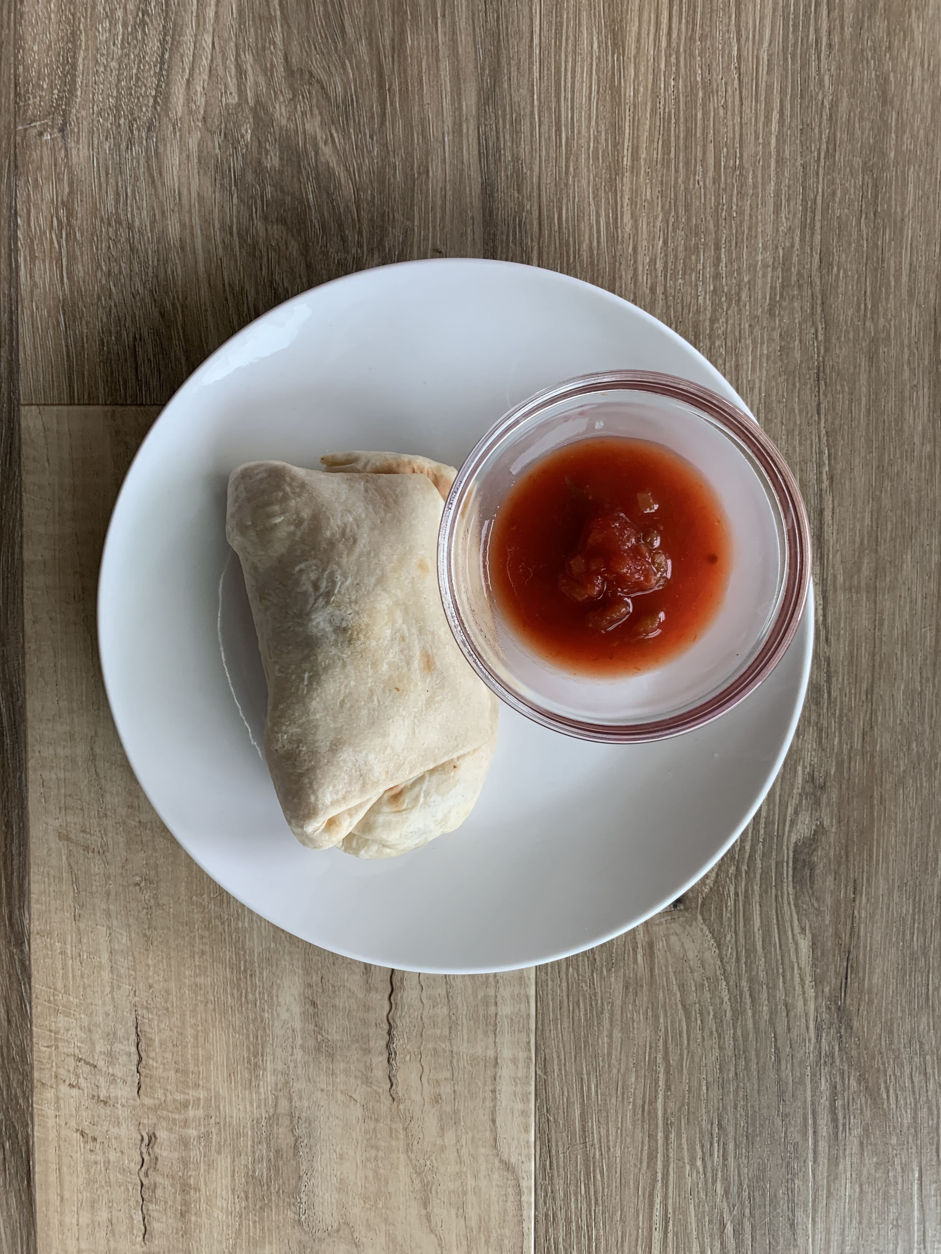Low Carb Burrito on white plate with salsa